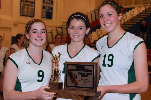 Captains (l-r) Kimmy Whitson, Maddie Kuppe, and Melanie Wade celebrate a second straight CCS title after defeating Menlo-Atherton High School in straight sets on Saturday.  Whitson recorded 32 assists, Kuppe had 16 digs, and Wade finished with 21 kills, as the Vikings beat the Bears, 25-19, 25-19, 25-14, for a second straight year.