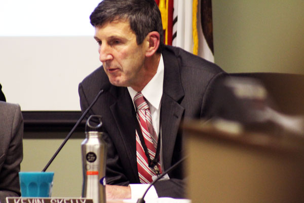 Palo Alto Unified School District Supt. Kevin Skelly listens in on a presentation at a March Board of Education meeting. Earlier this year, Skelly introduced a proposal that would beef up graduation requirements and allow select students to formulate customized graduation requirements.