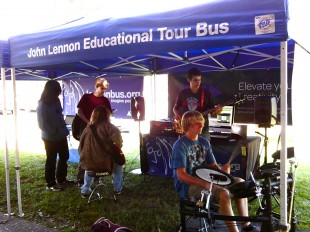 Outside the Bus, students play instruments provided by the organization during lunch on Sept. 20. Throughout the year, the Bus tours the country, helping students create and record original songs and music videos. Photo by Phoebe So.