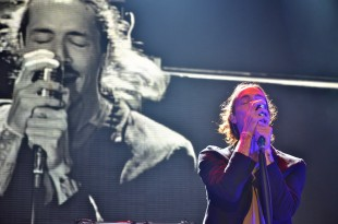 "Brandon Boyd sings along to his band's song, ""Pardon Me,"" as his video self is projected on the screen behind him."