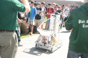 The Paly Robotics Club demonstrates one of their robots for students during Club Day.  The robot, moving independently, tossed a ball up and down, impressing the crowd of students that surrounded the demonstration.