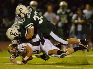 Erik Anderson (33) and Deante Williams (80) bring down Mitty's quarterback for a sack in Paly's home opener loss against the Monarchs Friday night.  Photo by Matt Ersted.
