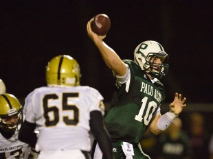 Quarterback Keller Chryst throws deep downfield in Paly's home opener loss against Archbishop Mitty High School Friday night.  Photo by Matt Ersted.