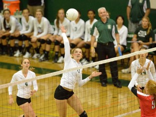 Lauren Kerr goes up for a spike in the first set of Paly's straight-set home win against crosstown rival Gunn High School.  Photo by Matt Ersted.