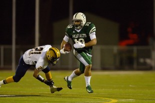Senior running back Matt Tolbert evades a Milipitas tackler in Paly&#039;s home defeat on Friday night.