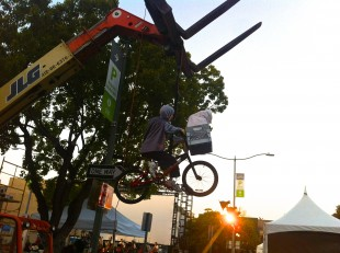 "A figure depicting Elliott and E.T. hangs from a crane at the screening of ""E.T. the Extra-Terrestrial."" The figure is imitating the iconic scene where Elliott and E.T. bike to the forest. Photo by Levi Schoeben."