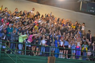 The seniors of 2013, dressed in 90's clothing, pass on the spirit chant to the freshman. [Photo: Cathy Rong]