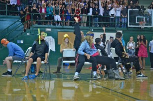 Senior Sierra Parker beats out sophomore Olivia Scola to secure a seat in musical chairs. [Photo: Cathy Rong]