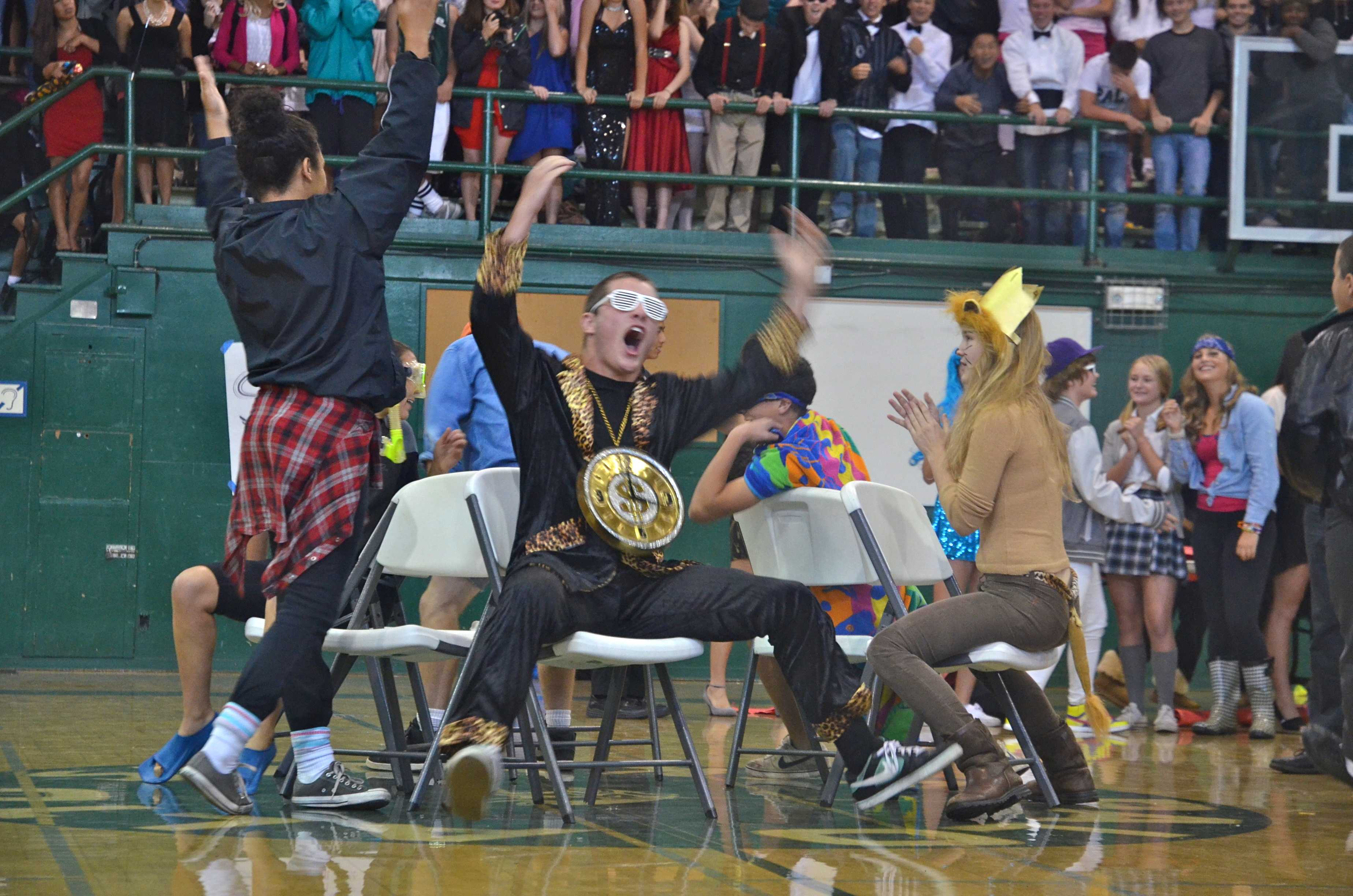 Junior Andrew Frick celebrates as he pushes a sophomore out of musical chairs. [Photo: Cathy Rong]