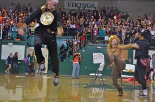 Juniors Callie Walker and Andrew Frick celebrate their win of musical chairs for the class, bringing home 400 points. [Photo: Cathy Rong]