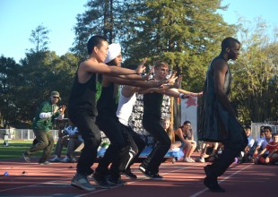 "Michael Johnson ('12) dances to ""Can't Touch This"" by MC Hammer during the seniors' spirit dance. [Photo: Cathy Rong]"