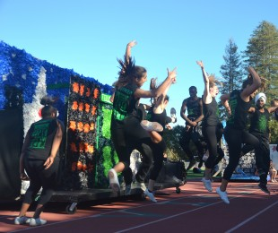 Seniors jump in synchronization during their spirit dance. [Photo: Cathy Rong]