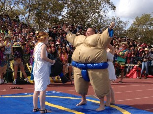 Senior Spencer Drazovich pumps up the crowd before his sumo wrestling match on the second day of Spirit Week.  He went on to win first place over junior Andrew Frick.  Photo by Jared Schwartz.
