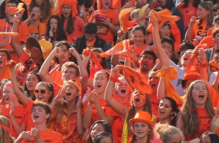 The Freshman dressed in orange, their class color, cheer during the rally at lunch. Photo by Phoebe So.