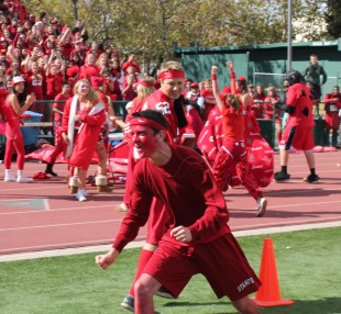 The sophomores celebrate their win against the freshmen in the third round of the relay races, placing third in the activity. Photo by Phoebe So.