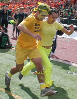 Juniors Josh Totte and Andrea Clerici-Hermandinger sprint to end of the three-legged race in the final round against the seniors, winning the relay race. Tomorrow's rallies will include a hula hooping and tug-o-war activity during lunch and a three-point contest and dunking basketball competition during Advisory. Photo by Phoebe So