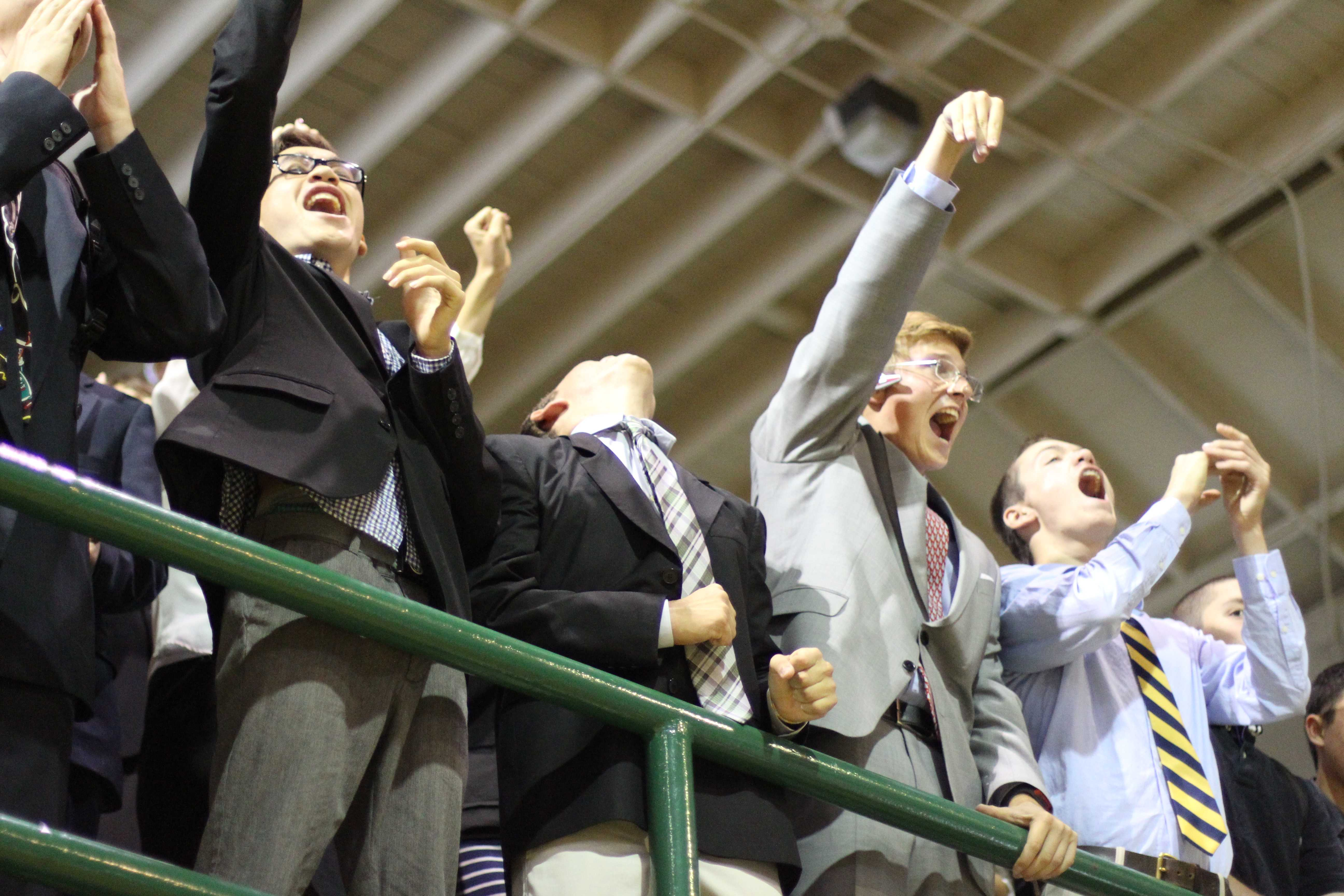 Juniors cheer from the bleachers during the Spirit Rally after school. [Photo: Cathy Rong]