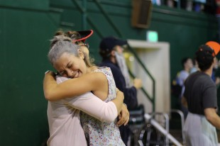 Senior Bria Vinceti huggs a friend after the senior victory in the slam-dunk competition. [Photo: Cathy Rong]