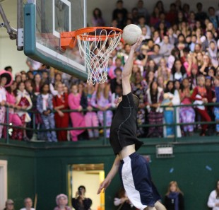 Junior Nick Sullivan tries for the slam dunk during the after-school rally. [Photo: Cathy Rong]