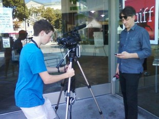 Brook setting up an interview with Brian Knappenberger, director of We Are Legion: The Story of The Hacktivists.&quot; Photo by Claire Liu.