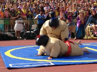 Concerns have been raised over student safety during Spirit Week, particularly during the sumo wrestling competition. In this photo, junior Andrew Frick takes down sophomore Nick Beeson. Photo by Jared Schwartz