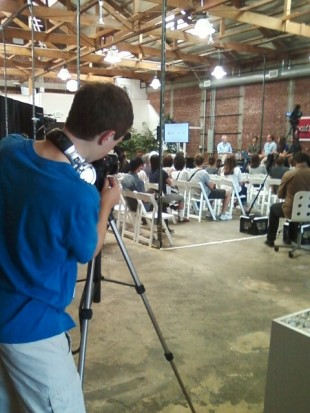 Sophomore Jack Brook films a festival talk at Palo Alto's Talenthouse. Photo by Claire Liu.