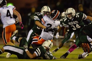 Senior Linebacker Erik Anderson stuffs the Los Gatos running back in the second quarter of Paly's 25-7 victory over the Wildcats Friday night.  Photo by Matt Ersted.