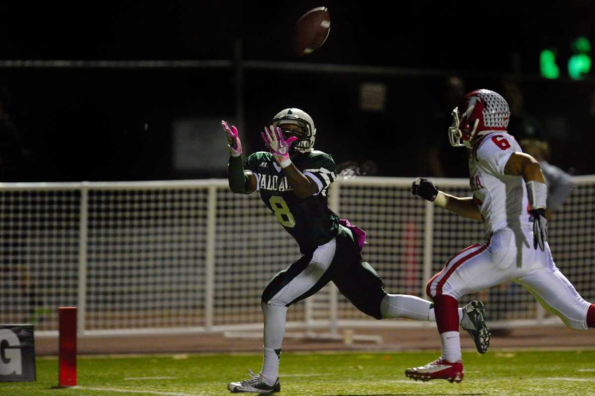 Junior wide receiver Malcolm Davis hauls in a long pass from quarterback Keller Chryst for a touchdown in Paly's homecoming win over Saratoga High School Friday night.  Photo by Matt Ersted.