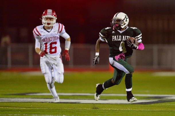 Senior running back Justin Gates-Mouton runs past a Saratoga High School defender for a long touchdown in the third quarter of Paly's homecoming win over the Falcons Friday night.  Photo by Matt Ersted.