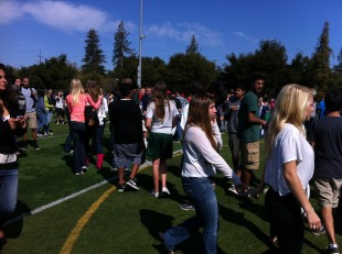 Students search for their fourth period teachers while on the field.