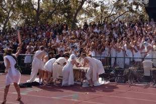 Seniors fashioning togas cheer for their best dressed on day two of Spirit Week at the football field at lunch.  The seniors will be wearing green tomorrow.  Photo by Jared Schwartz.
