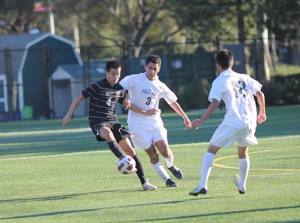 Junior forward Cina Vazir jostles for position against a Gunn defender. Vazir was able to control the tempo in favor of the Vikings, according to senior captain Kirby Gee, who attacked the Titan defense the whole game.