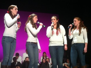 "The Heartbeats perform The Beatles' ""Here Comes the Sun."" The group is the female answer to the all-male Heartbreakers. From left to right: junior Sarah Ohlson, senior Isabel Benatar, sophomore Jamie Garcia and junior Hannah Wilson. Photo by Paige Esterly."