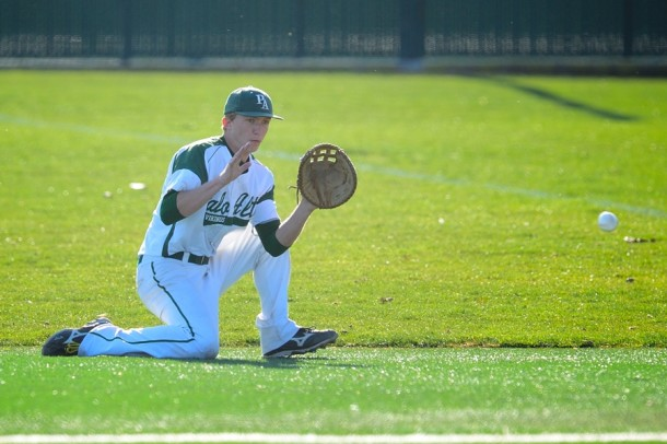 Senior first baseman Rowan Thompson fields a sharp grounder from his knees in the first inning of Paly's first home game against St. Ignacius High School.  Photo by Matt Ersted.
