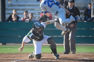 Junior catcher Austin Krohn tags out a St. Ignacius player ay home plate in Paly's 9-3 loss to the Wildcats Wednesday afternoon.  Photo by Matt Ersted.