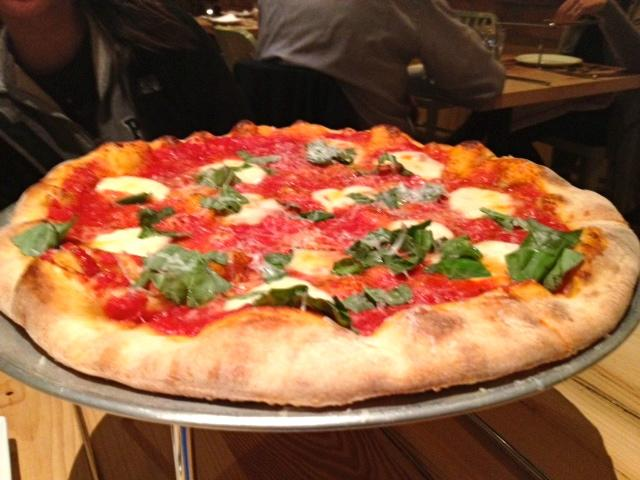 The margherita pizza, $13, was dotted awkwardly with cheese and basil, but was flavorful and cooked just right. Photo by Addie McNamara.