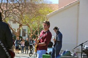 Senior Ben Cook plays guitar during Paly Rocks. Photo by Cathy Rong