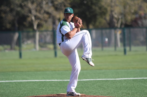"Junior pitcher Danny Erlich winds up to pitch against Gunn on Friday. Erlich held the Titans to just two runs, both in the first inning. ""Danny's pitching really helped us get our momentum back later on,"" senior designated hitter Isaac Feldstein said. Photo by Neal Biswas."