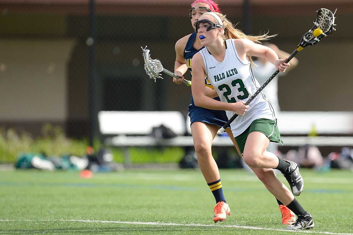 Current senior co-captain Kristen DeStefano dashes past an Oak Ridge High School defender and towards the goal a 15-3 Paly 15-3 victory over the Trojans last season. The Vikings will face off against Oak Ridge once more this Friday.  Photo by Matt Ersted.