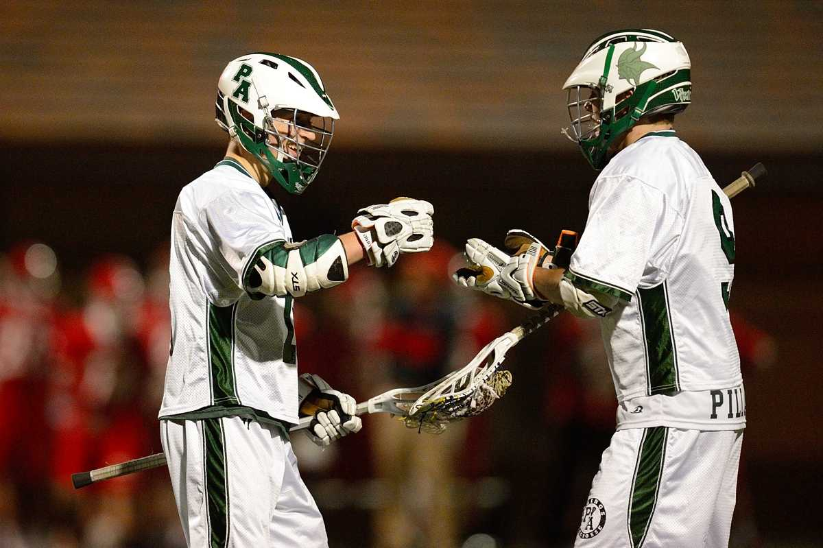 Seniors Skyler Anderson (left) and Weston Preising celebrate Anderson's goal in the second quarter of Paly's 12-11 home loss to Burlingame Monday night.  Photo by Matt Ersted.