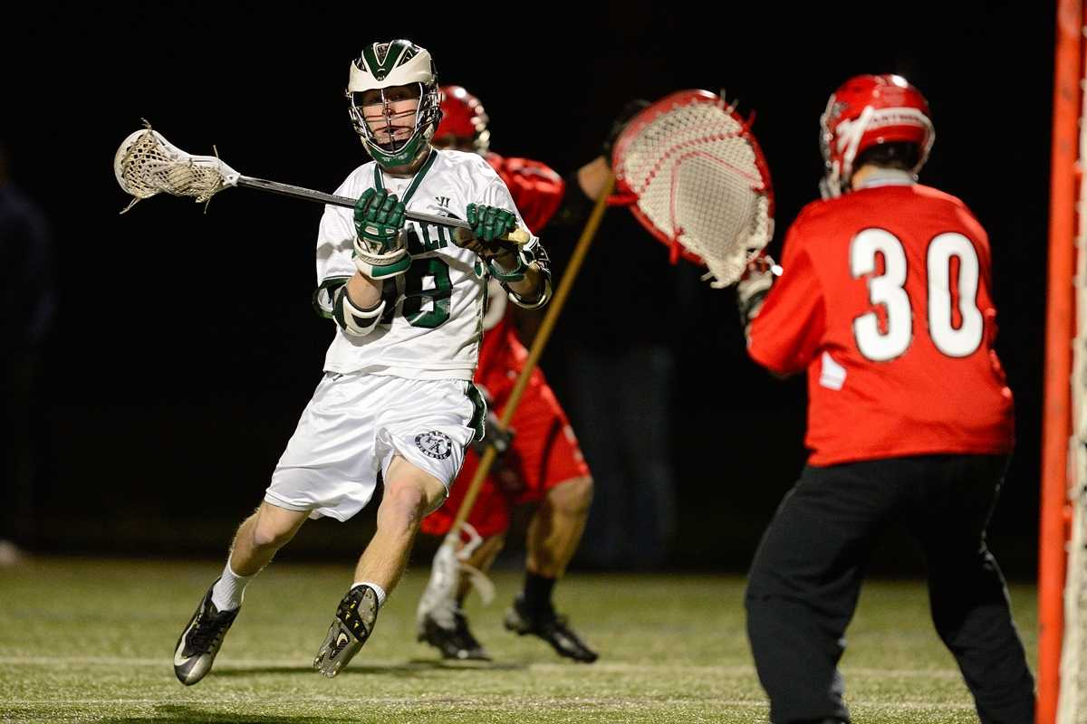 Senior Jonny Glazier attempts to deke the opposing goalie in Paly's close loss to Burlingame High School Monday.  Photo by Matt Ersted