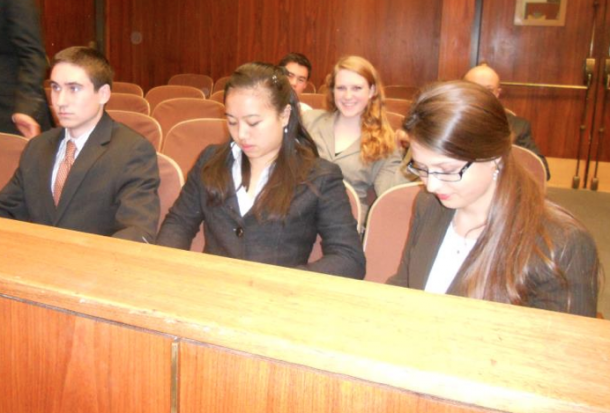 Mock trial team members Charlie Dulik, Jessica Tam and Sophia Sholtz prepare for a trial.