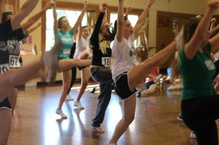 "Students perform kicks in an exercise led by current members of the varsity cheerleading team. This past year has been a successful one for Paly Cheer. ""We had a blast bonding at cheer camp, cheering for our football team ... and competing at Cheer Nationals in Las Vegas,"" said Haley Hammer, head coach of the Spirit Squad.  Photo by: Juliana Moraes-Liu"