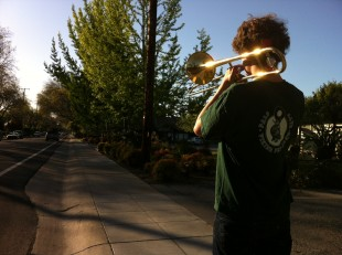 Junior Freddy Kellison-Linn practices marching with his trombone. Kellison-Linn, along with the rest of the Paly band, will be marching in the May Fete Parade Saturday, May 4. Photo by Paige Esterly