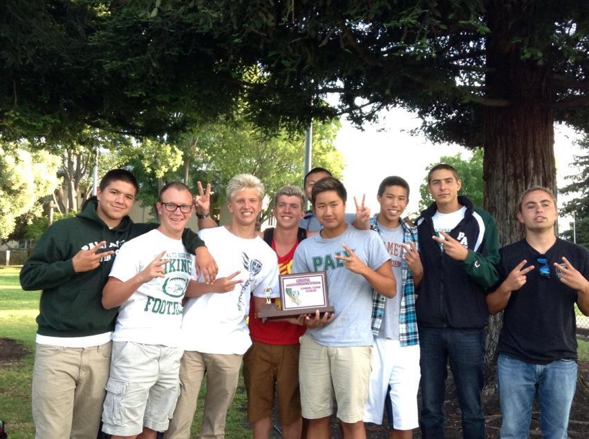 Paly Boy's swimming pose with each other after winning second at CCS in 2013. Photo by Sam Kelley.