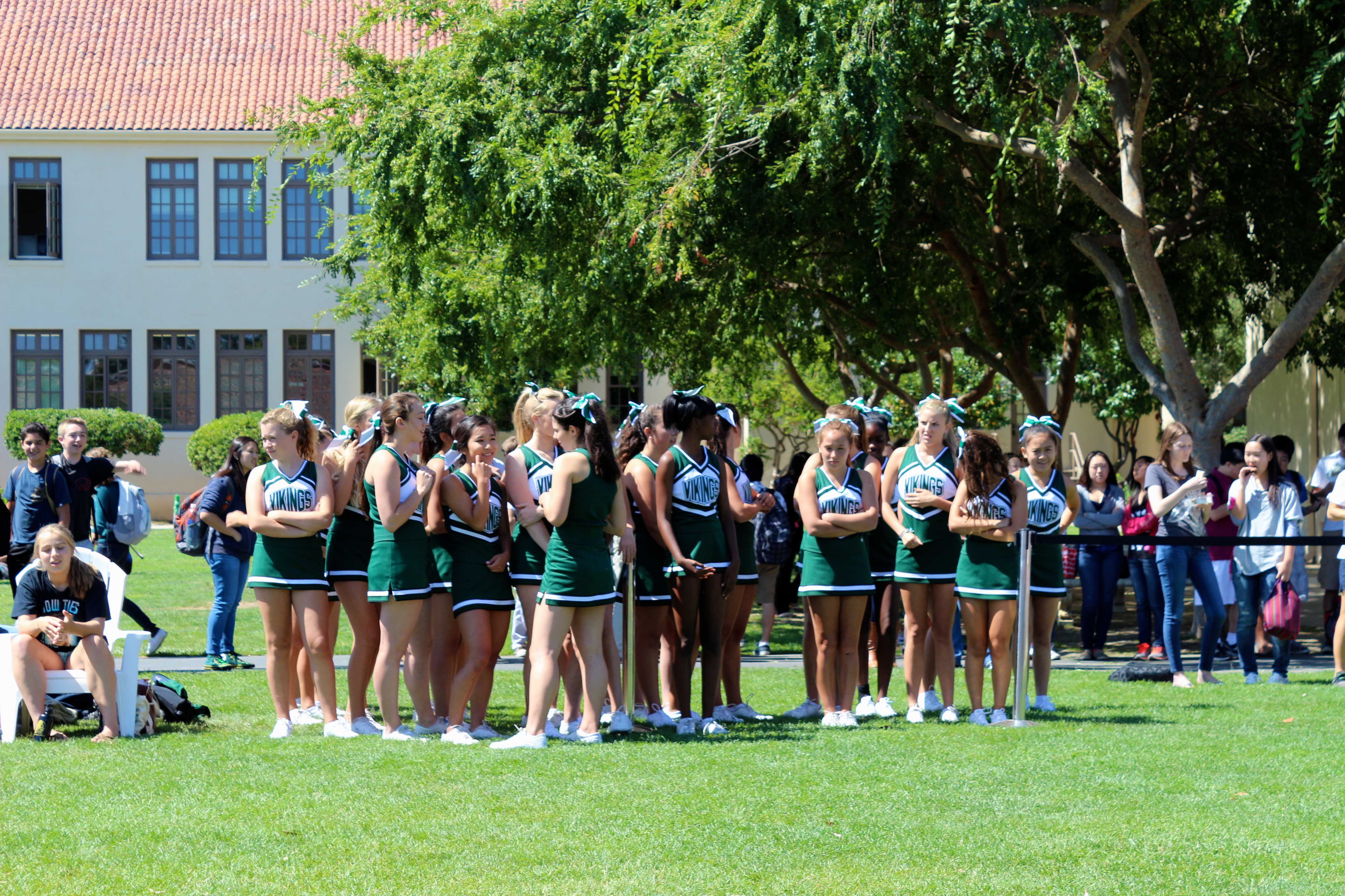 Cheerleaders gather before their performance. Photo by Frankie Comey