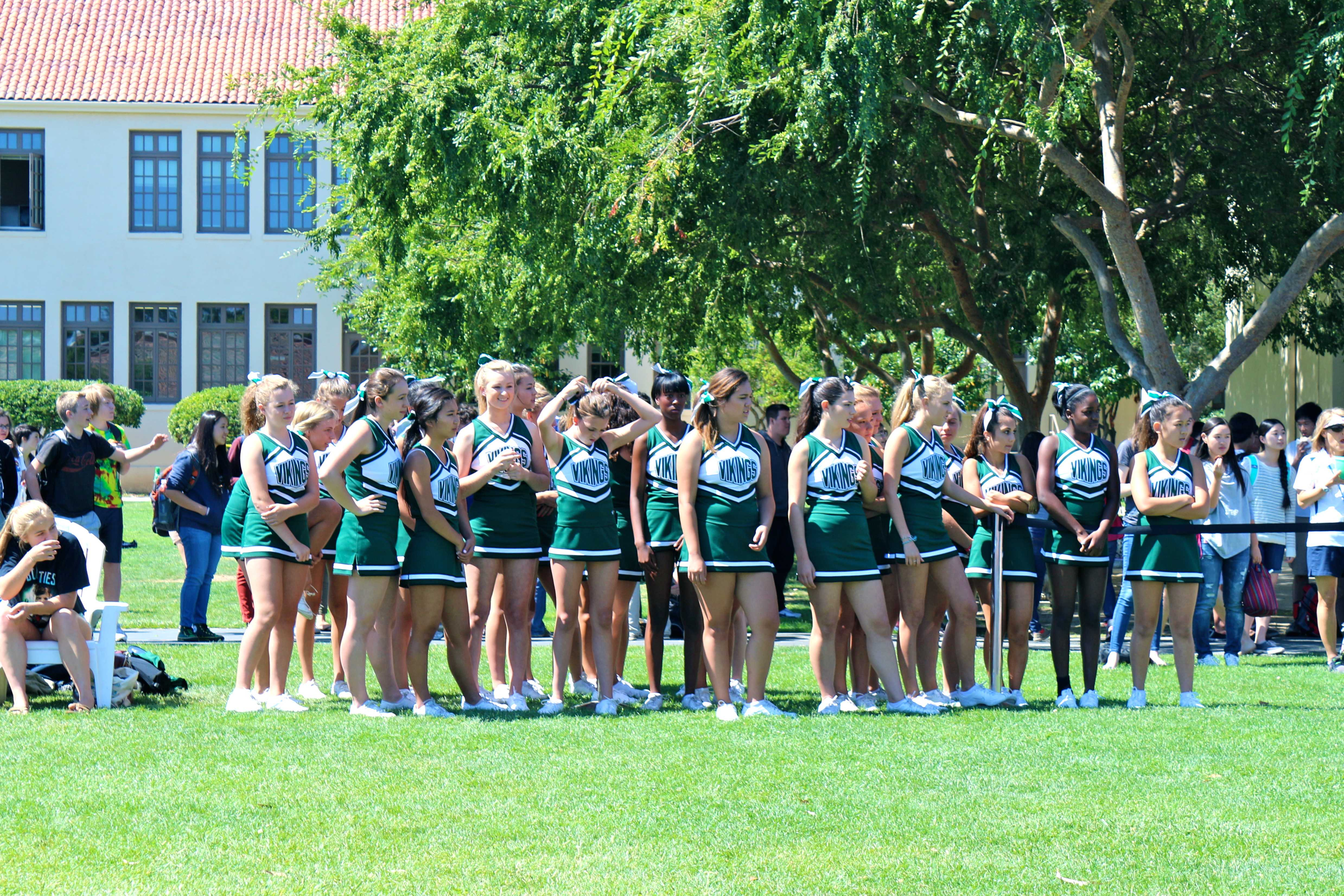 Cheerleaders prepare to return to center stage during the rally. Photo by Frankie Comey