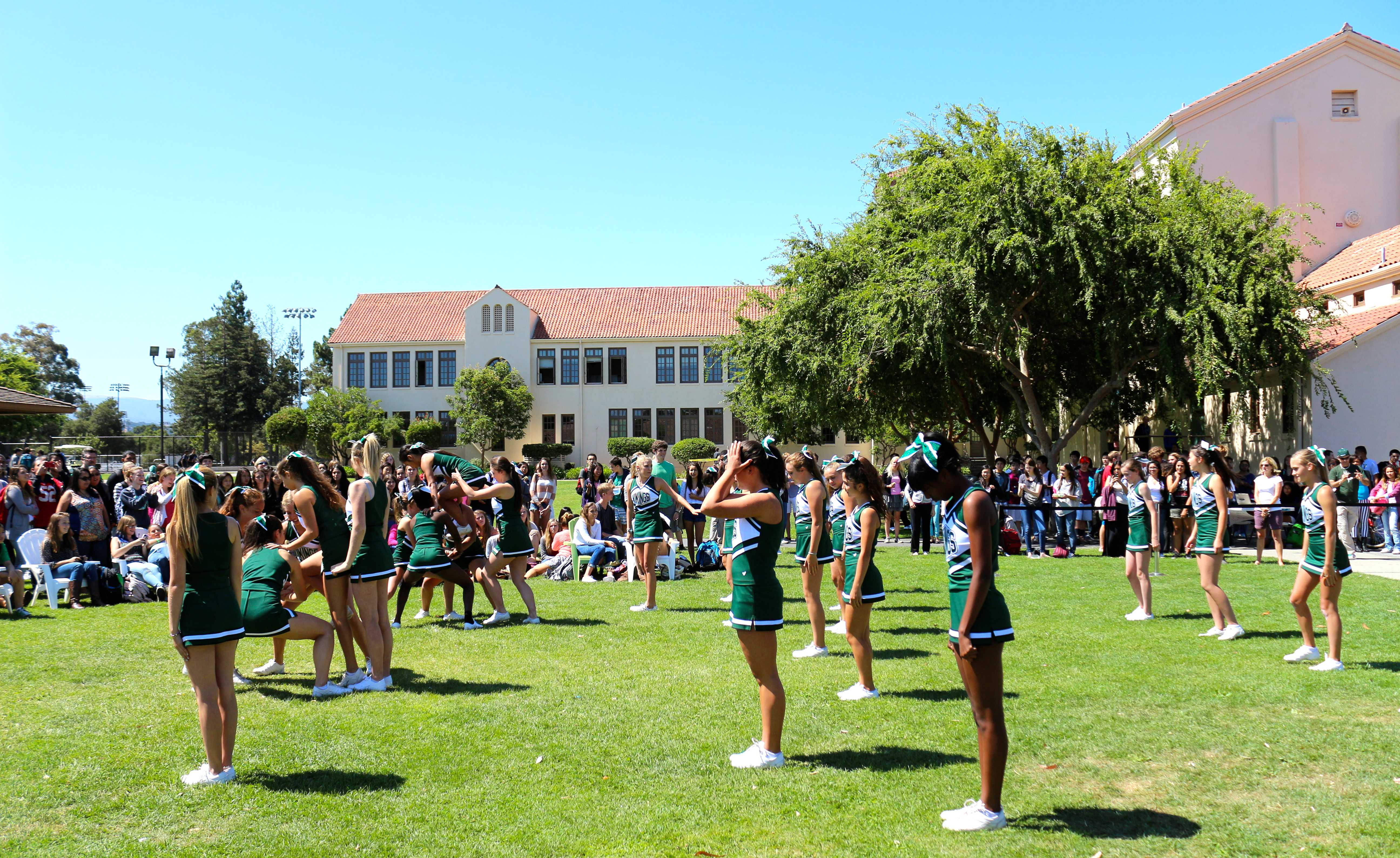 Cheerleaders gather into formation for their performance at the Back to School Rally. Photo by Frankie Comey