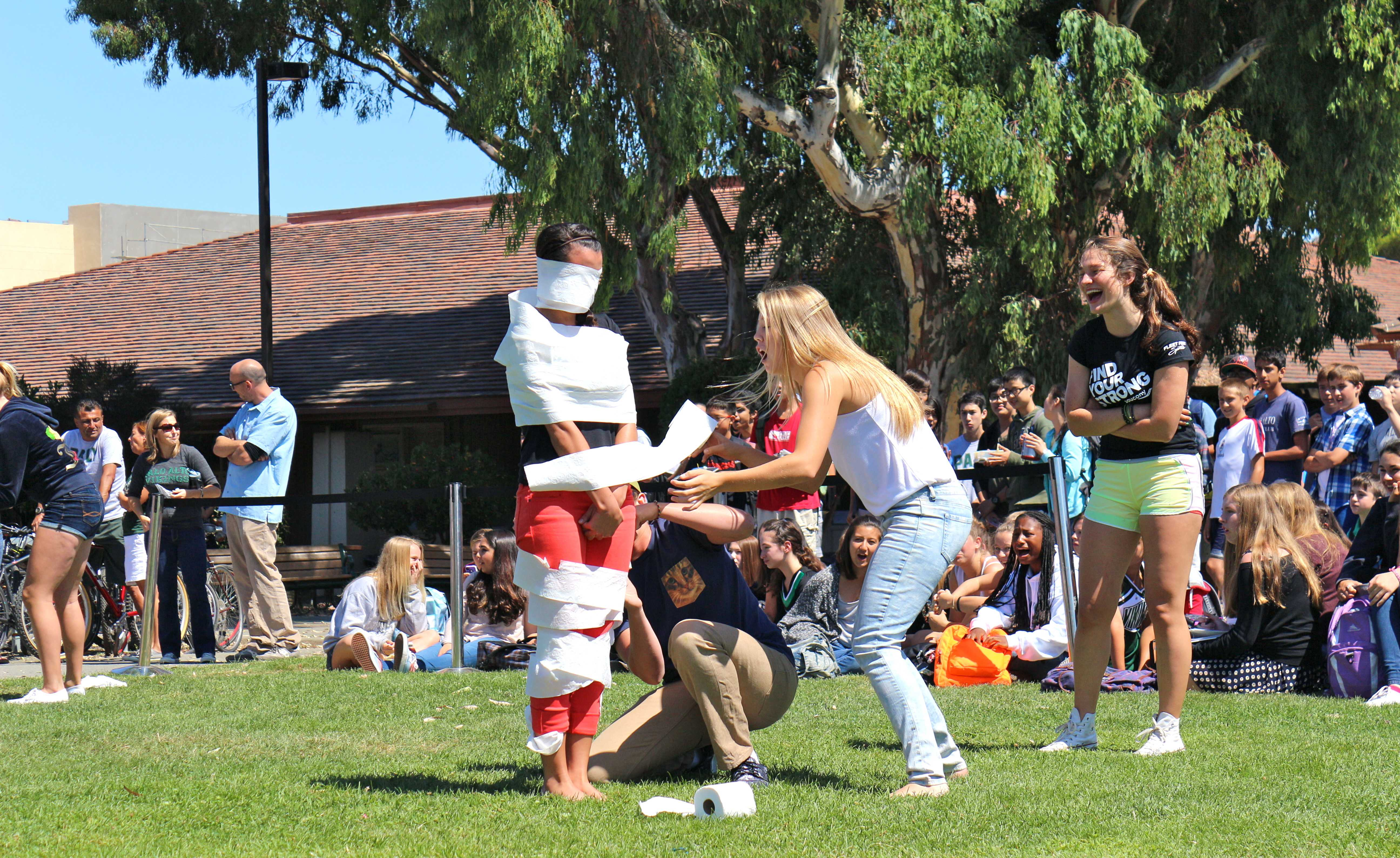"Students compete in ""Mummy Wrap"". Photo by Frankie Comey"