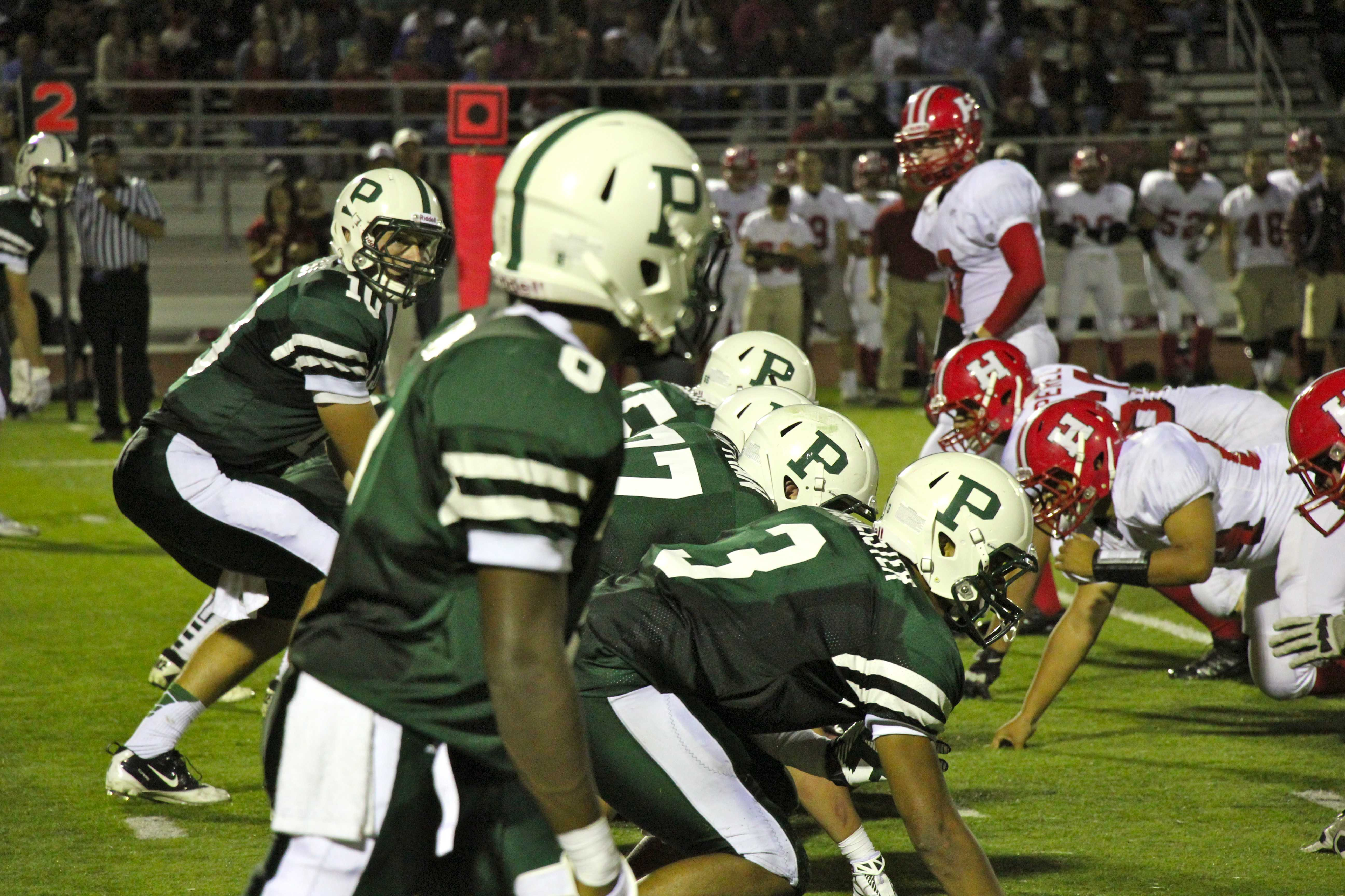 The Palo Alto High School varsity football team lines up on second down. Photo by Scott Andrews
